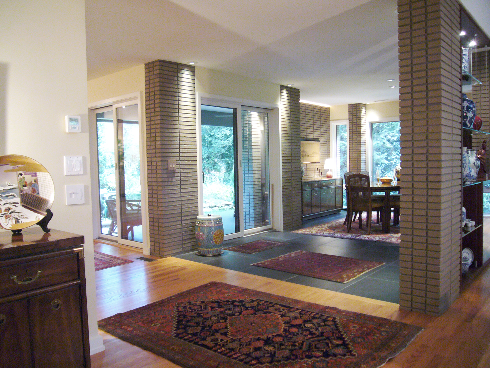 A Roman Brick Dining Area Addded to an Exterior Porch